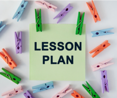 A sticky note with the words Lesson Plan surrounded by multi-colored clothes pins